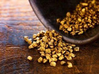 Колебливата цена на златото продължи резкия спад и падна до 20-месечно дъно.